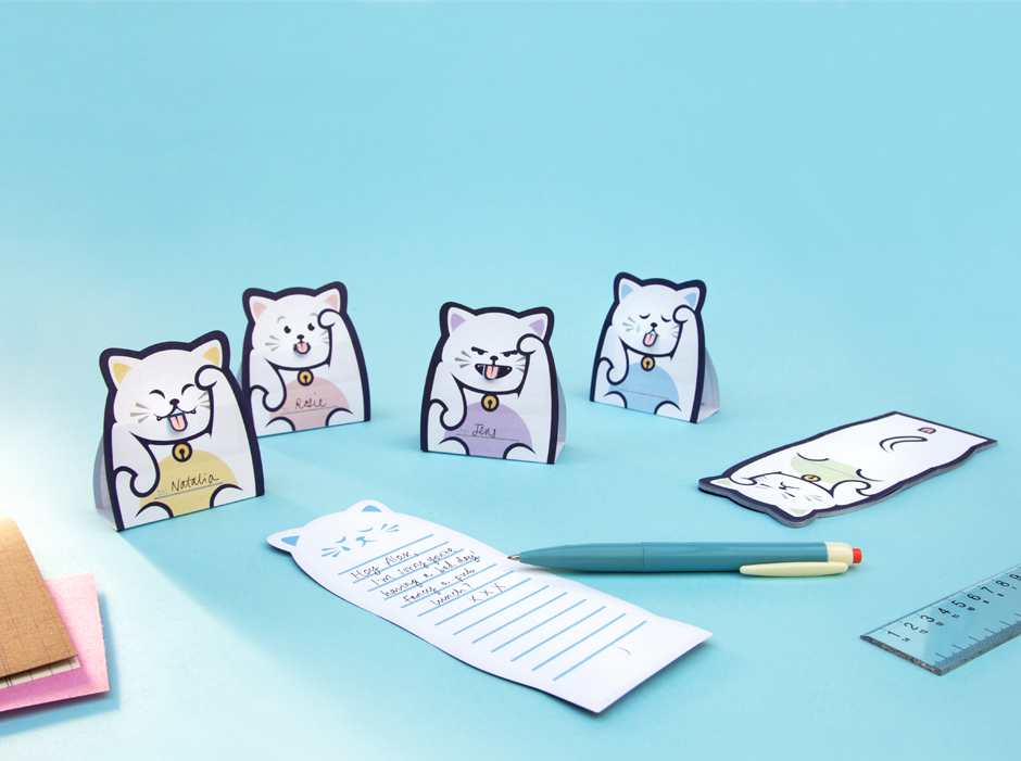 Lucky Cat Message Pads folded up on desk