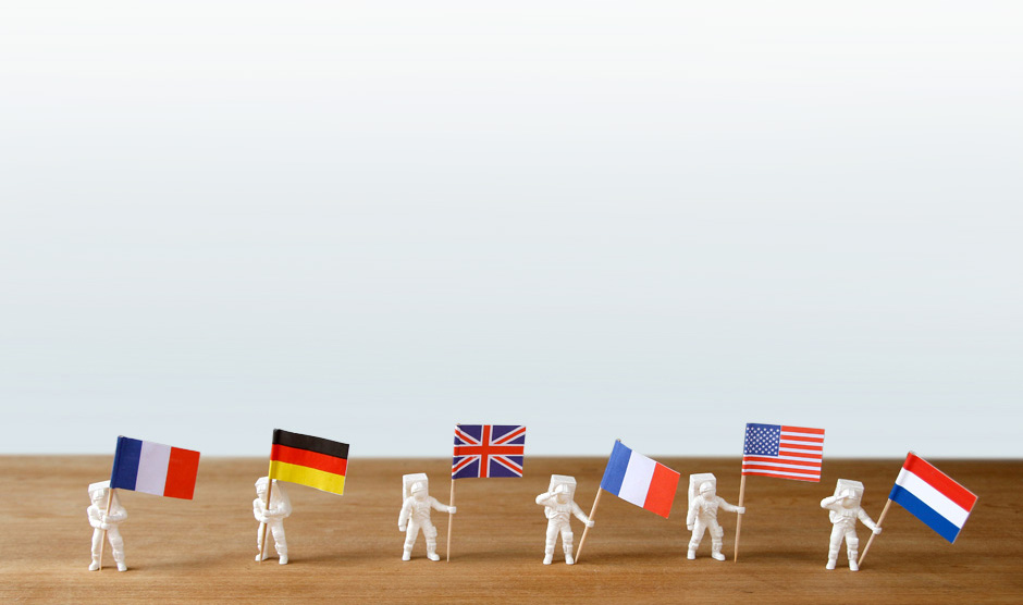 ASTRONAUT FOOD FLAGS in a line holding flags
