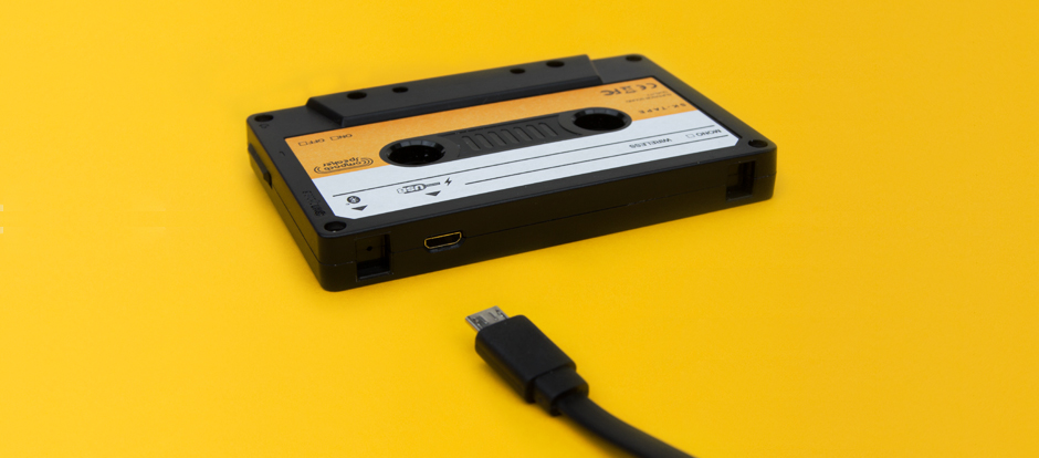 Close up of cassette speaker with charging cable