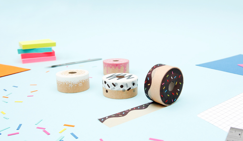 Doughnut tapes on desk with hundreds and thousands