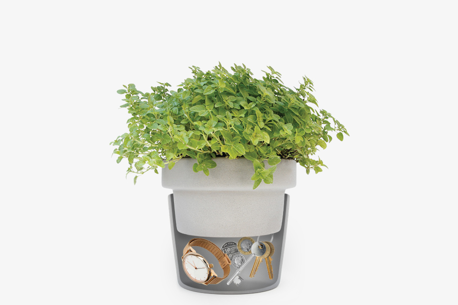 Plant pot hideaway split pot with watch keys and money