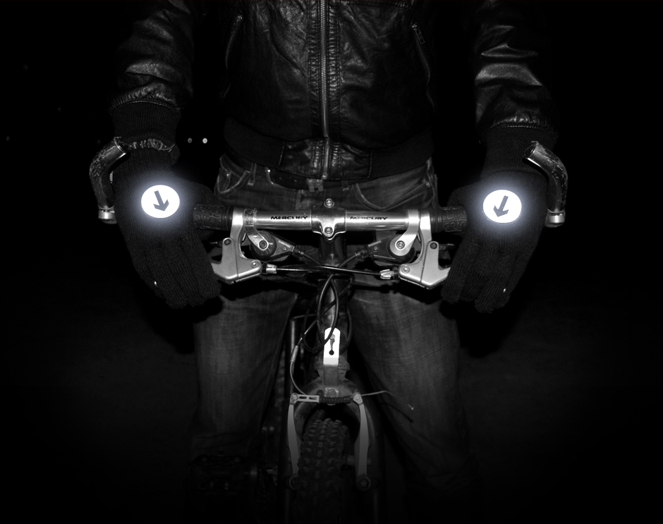 Holding bike handle bars wearing reflective biker gloves
