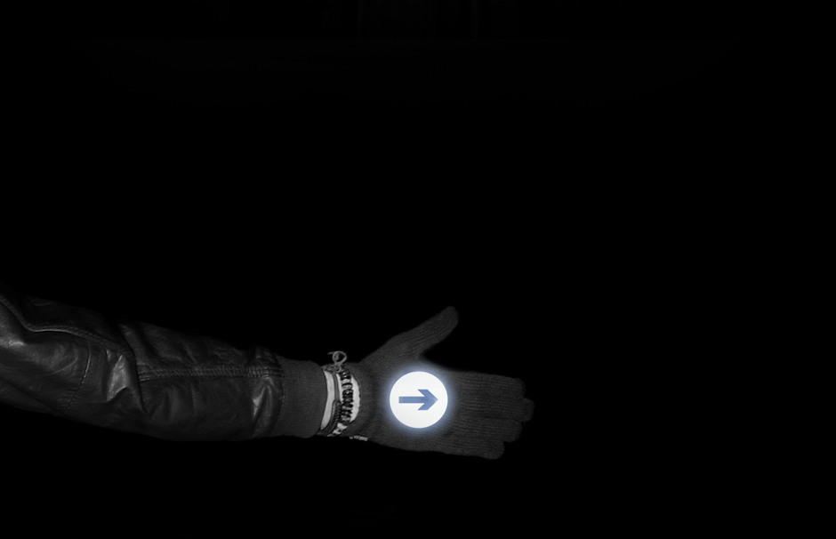 Hand indicating in reflective biker gloves at night