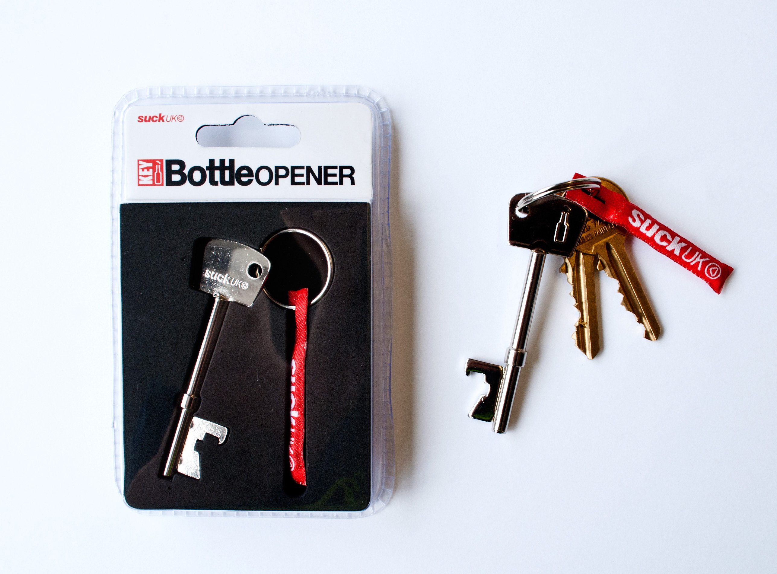 key bottle opener content gallery looks like a regular key opens bottles. Black Bedroom Furniture Sets. Home Design Ideas