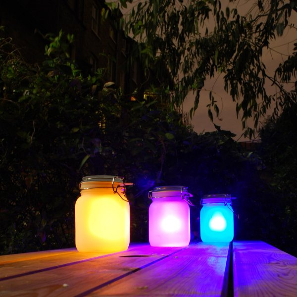 3 Sun Jars on a table at night