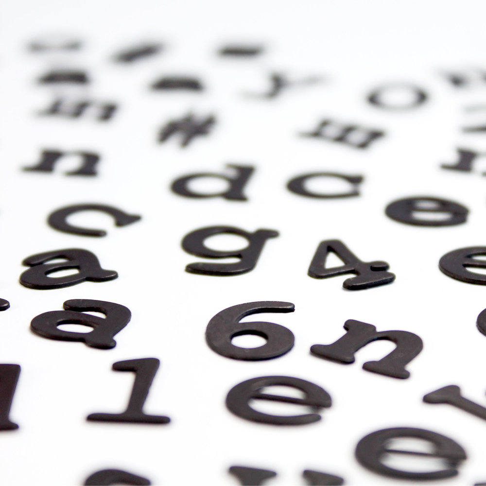 close up of black magnetic alphabet