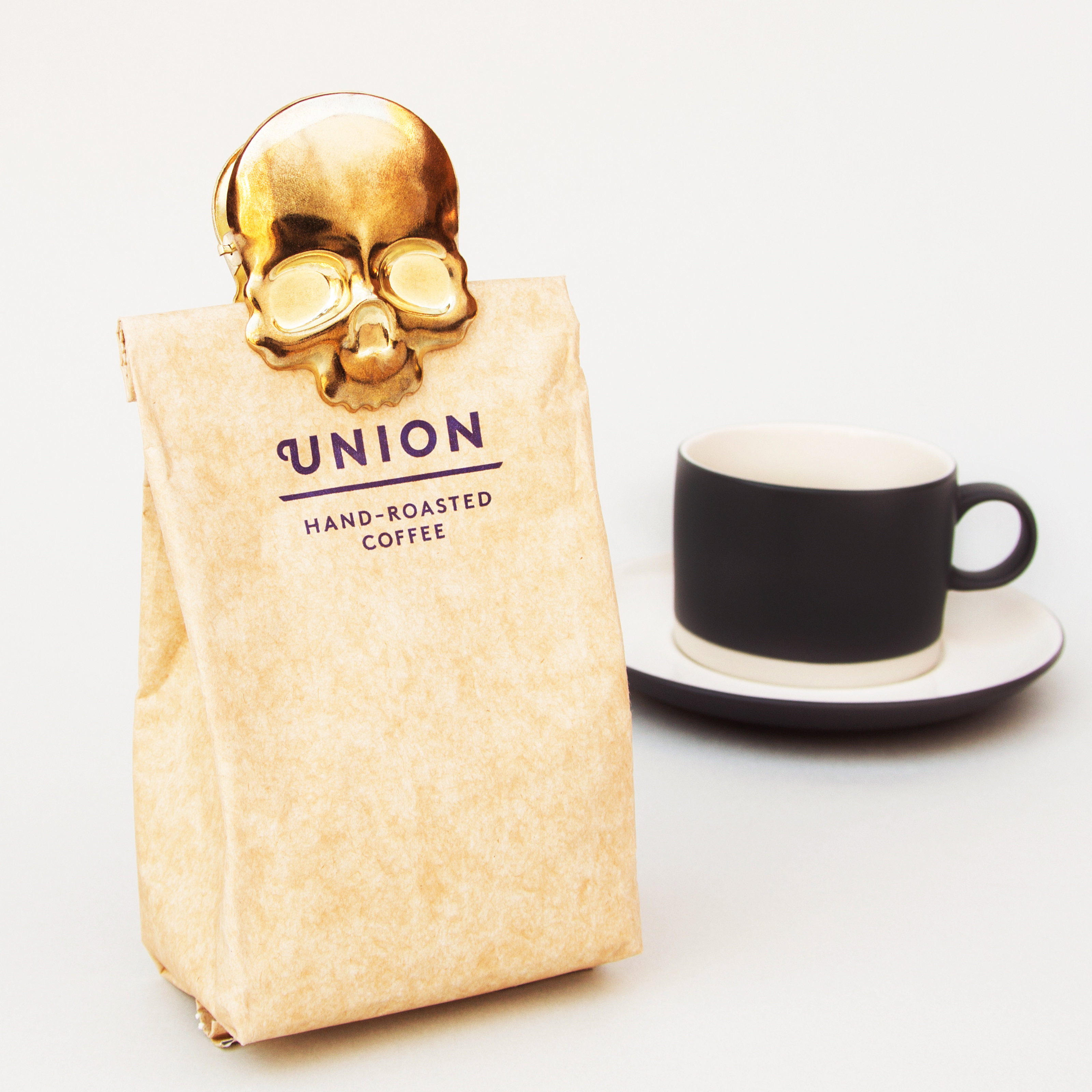 Skull clip sealing a bad of coffee beans