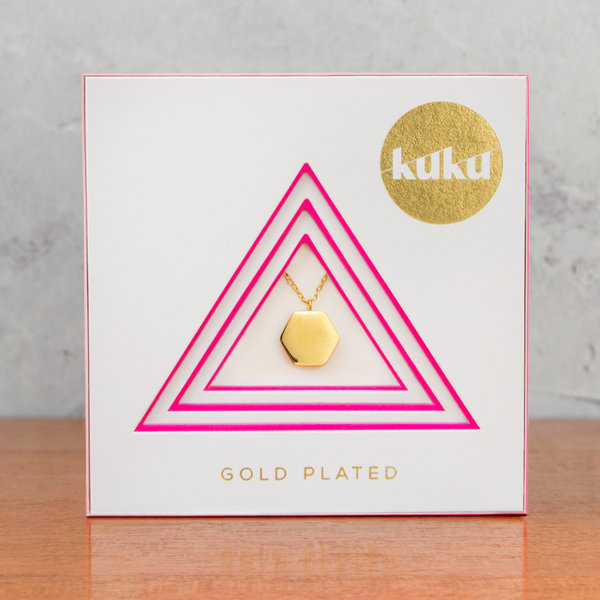 Kuku gold hexagon necklace in packaging