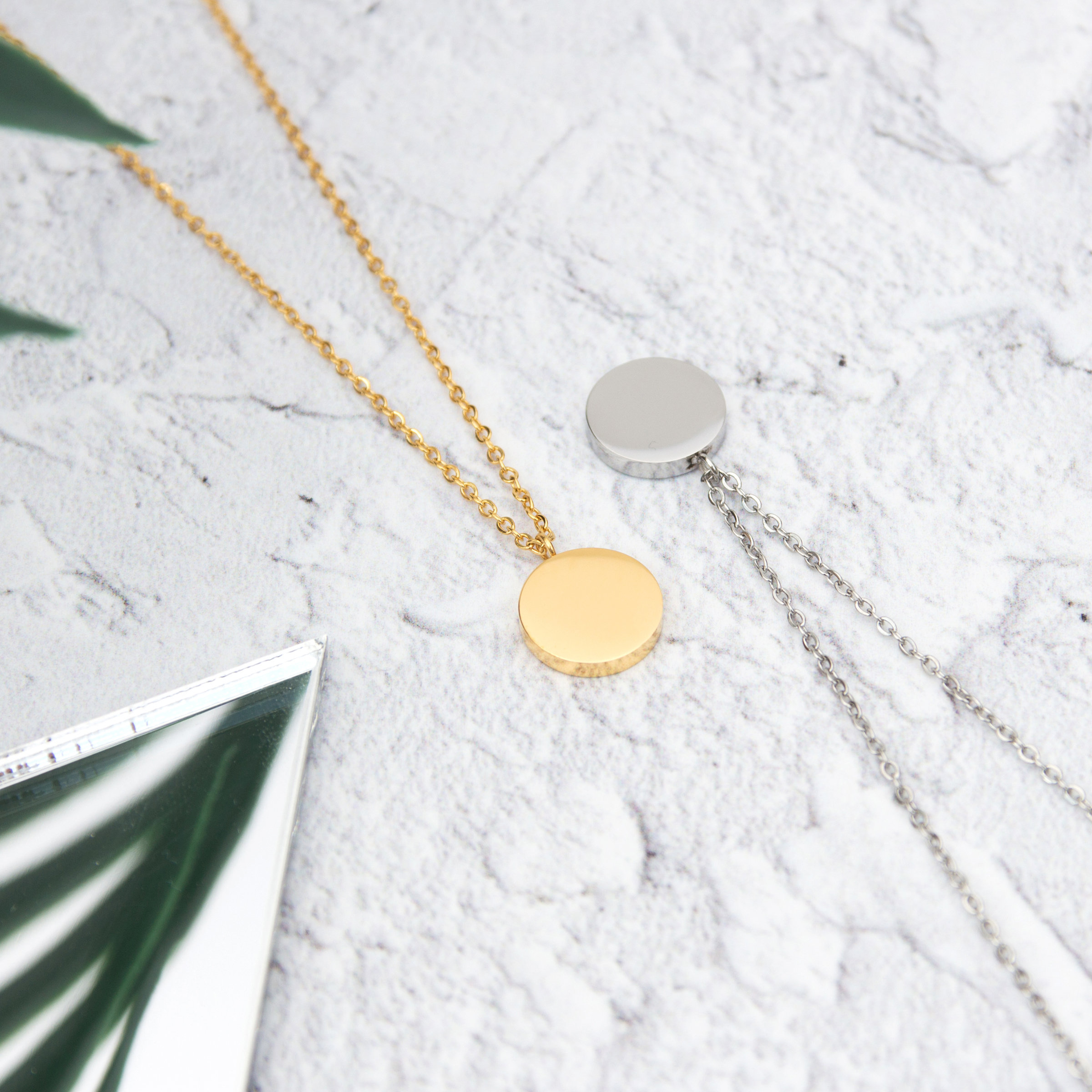 Kuku gold and silver circle necklace