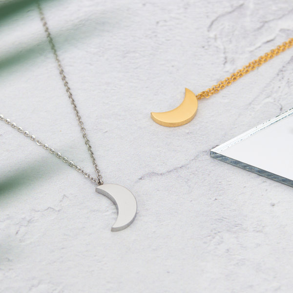 Kuku gold and silver crescent moon necklaces
