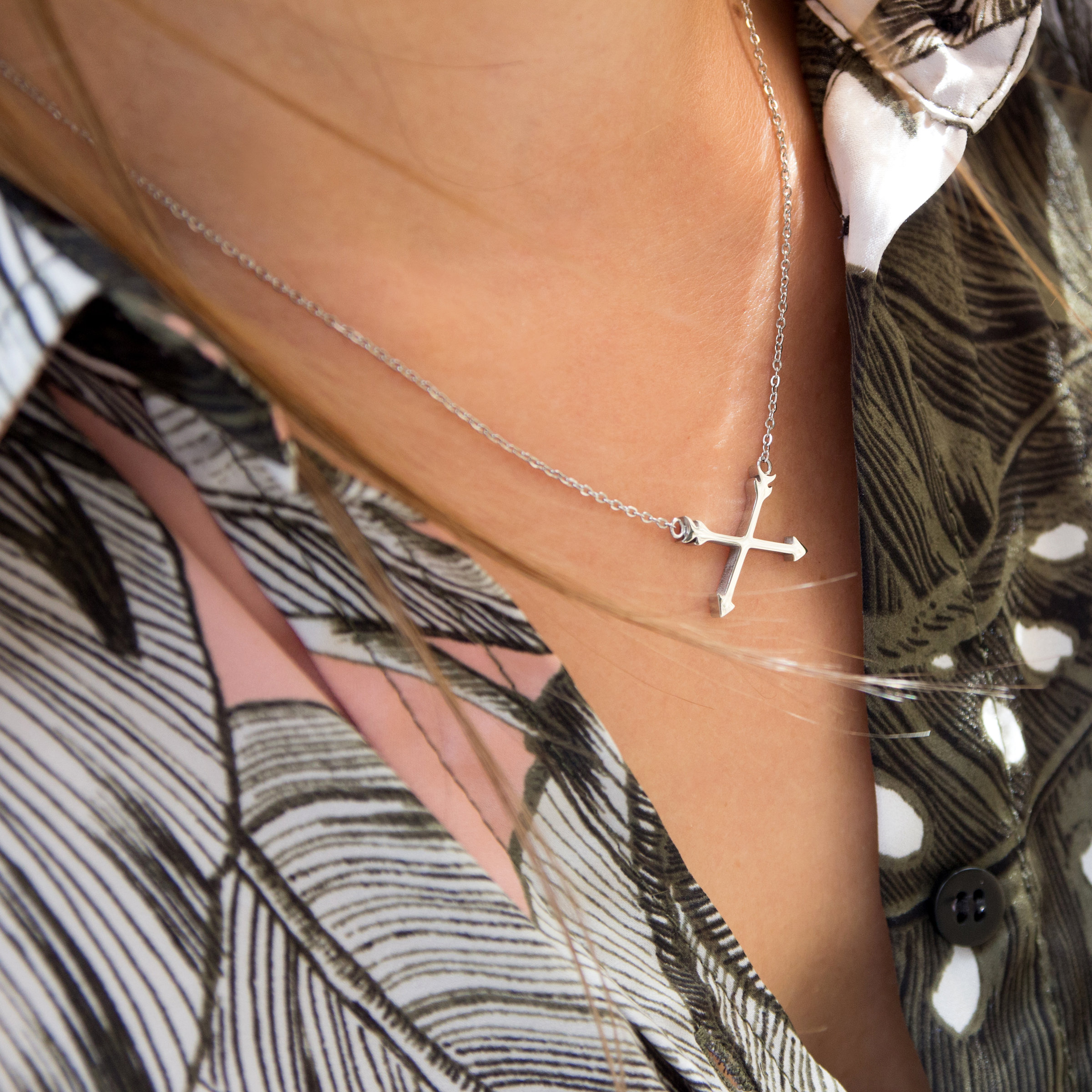Kuku silver arrow necklace on model