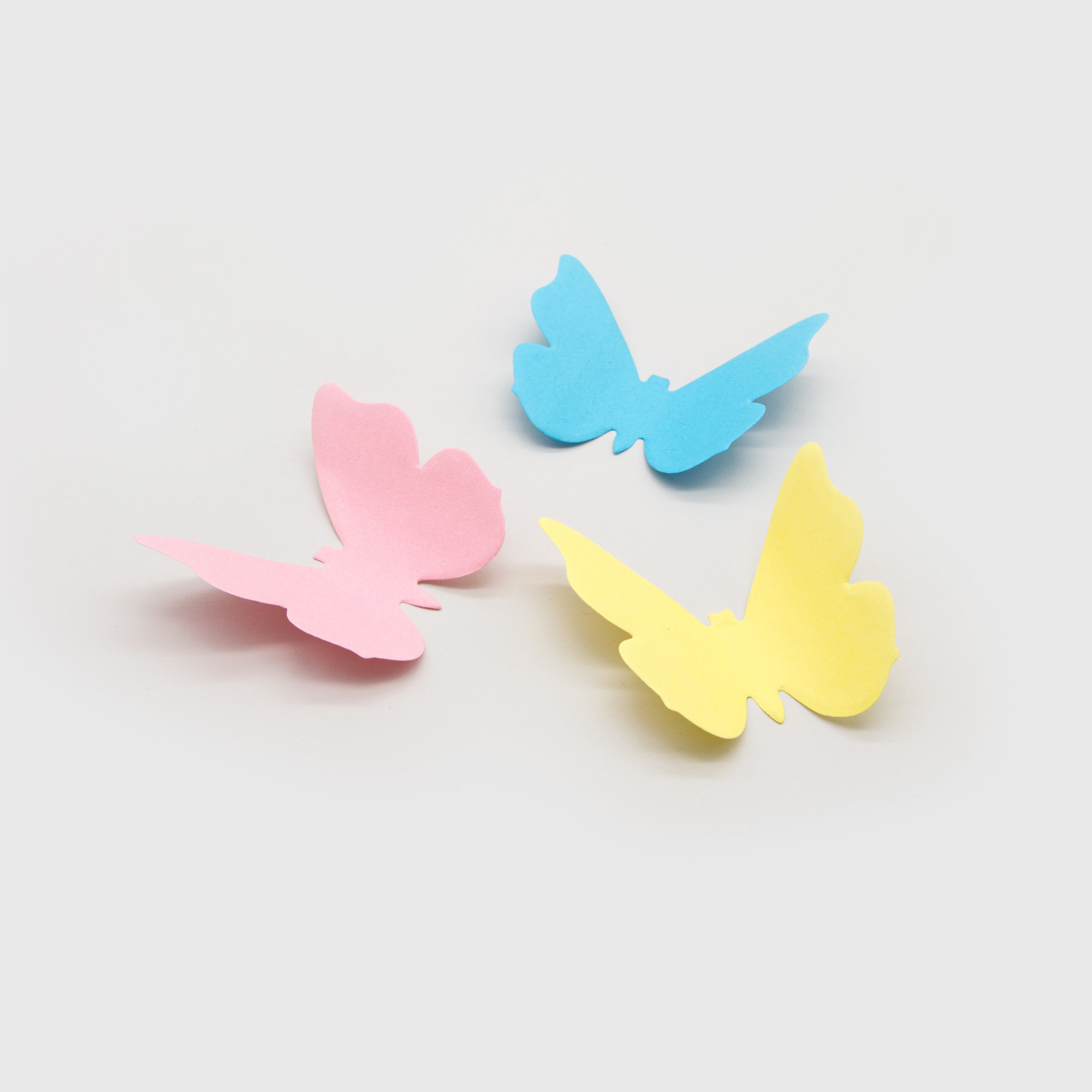3D butterfly sticky notes in pink, blue and yellow
