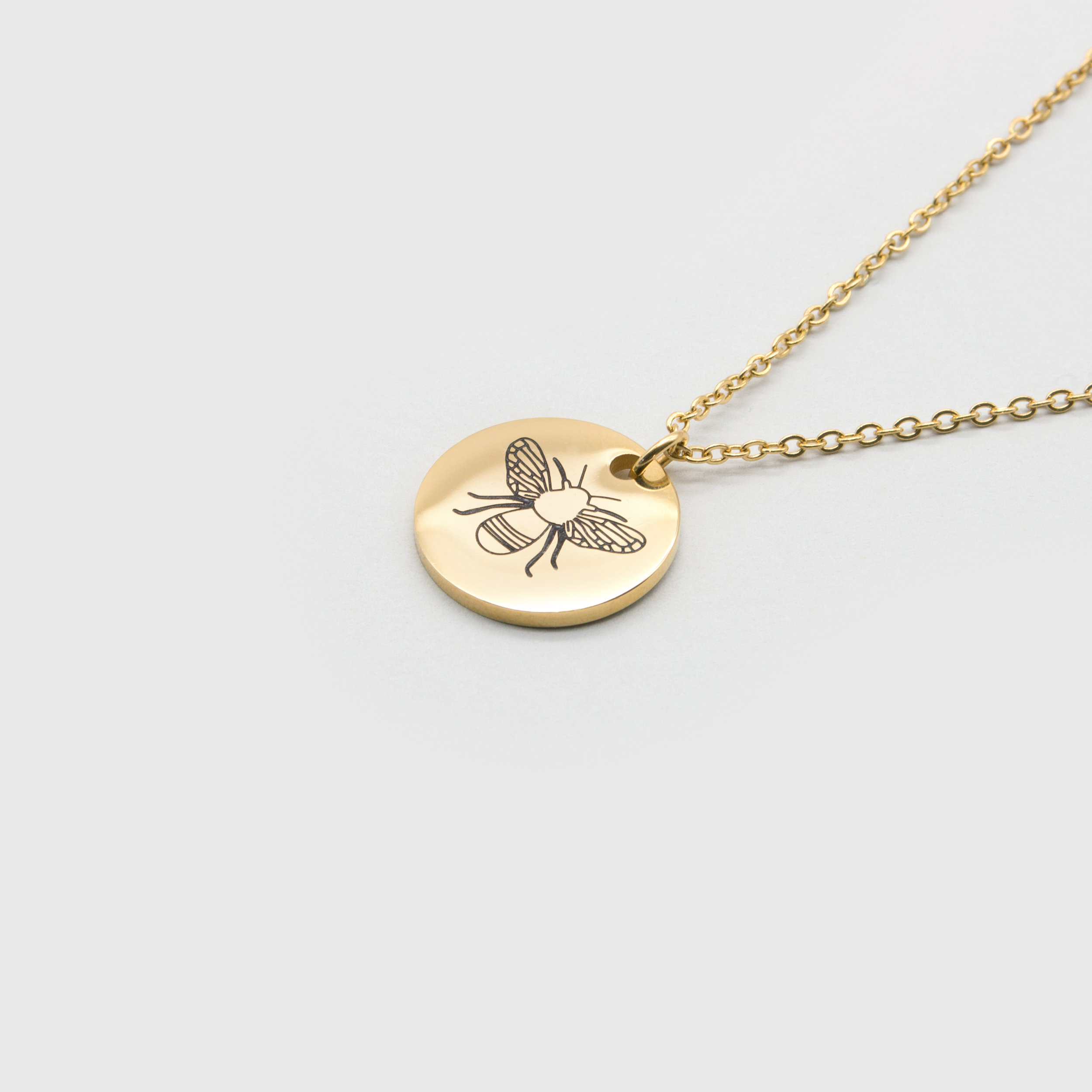Kuku gold bee necklace
