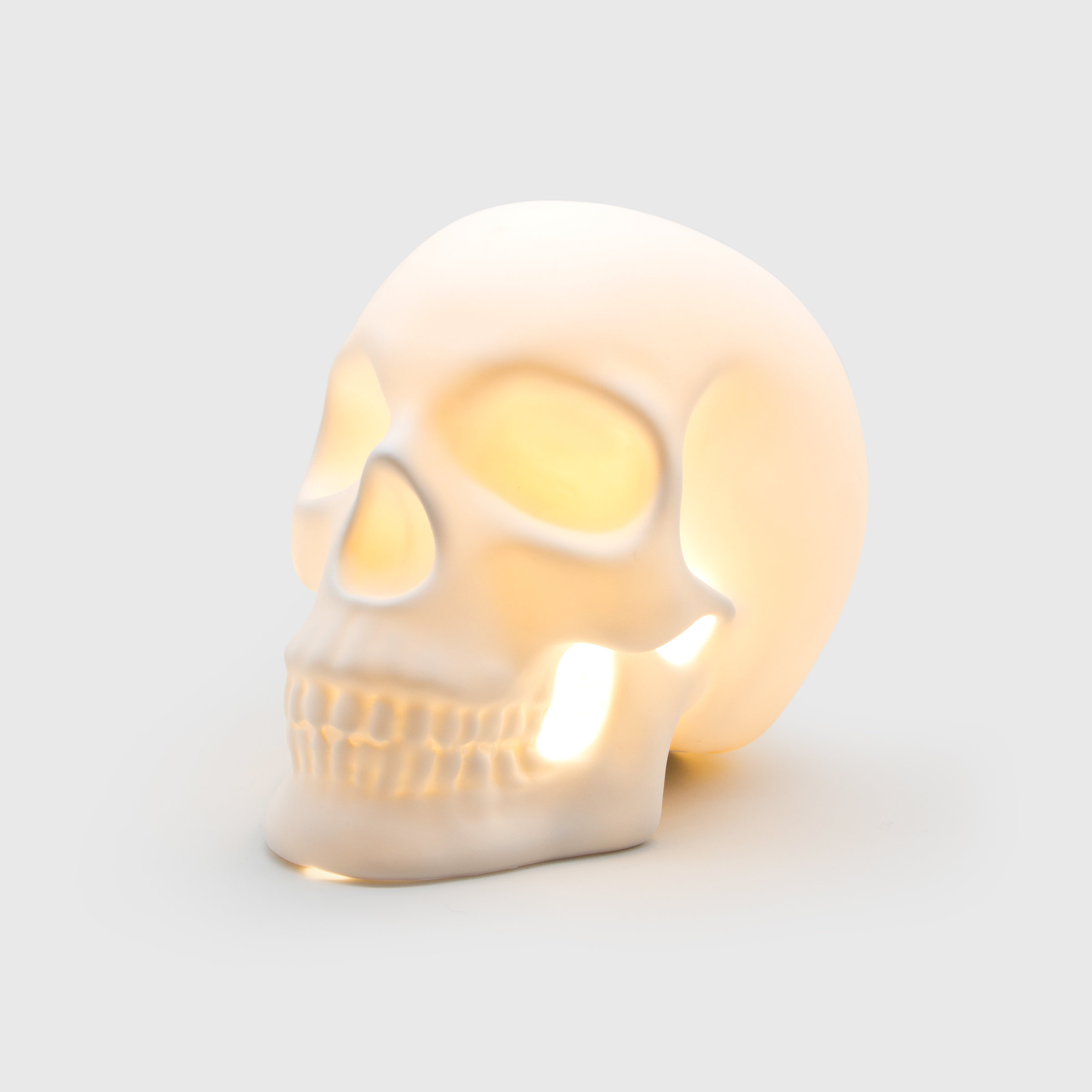 Decorative skull shaped lamp made from ceramic