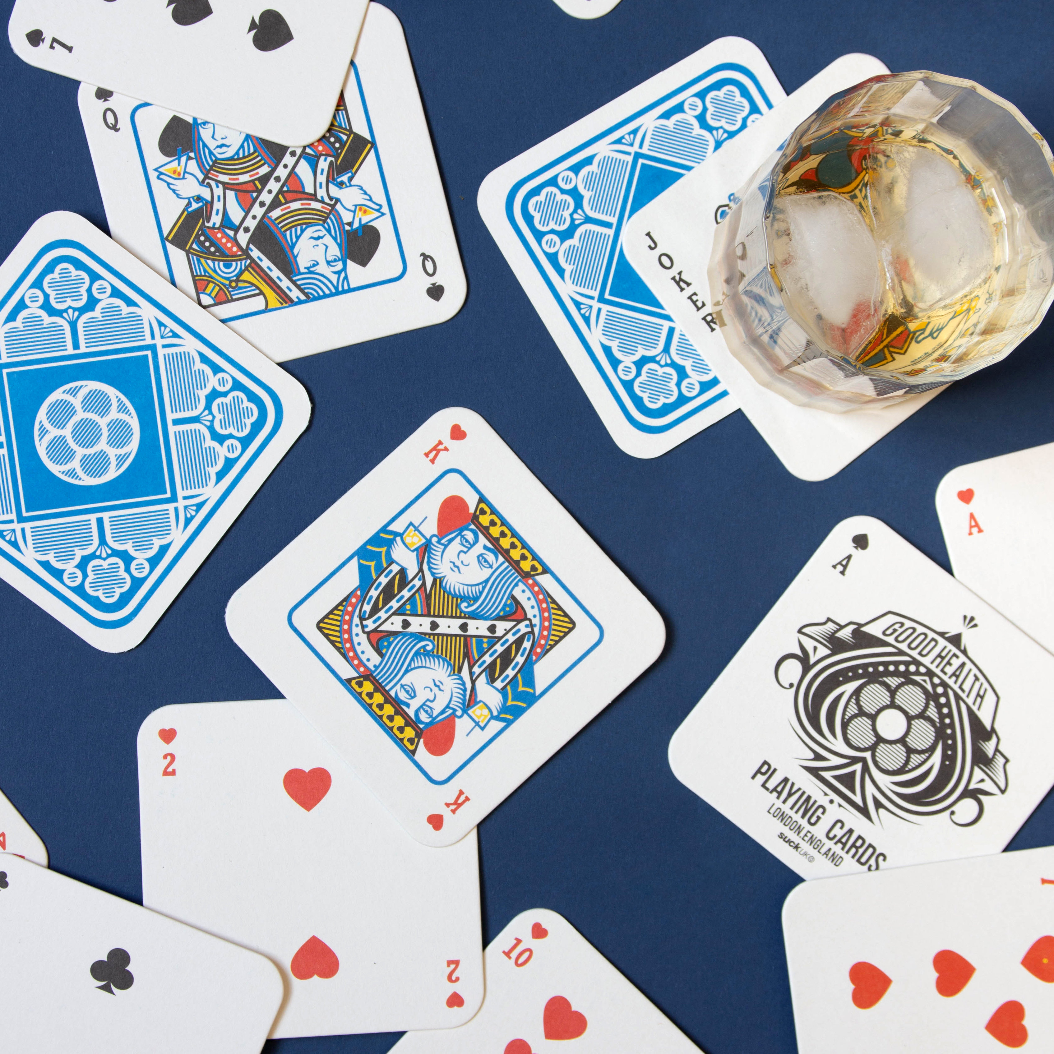 Playing Card Drink Mats Scattered On Table