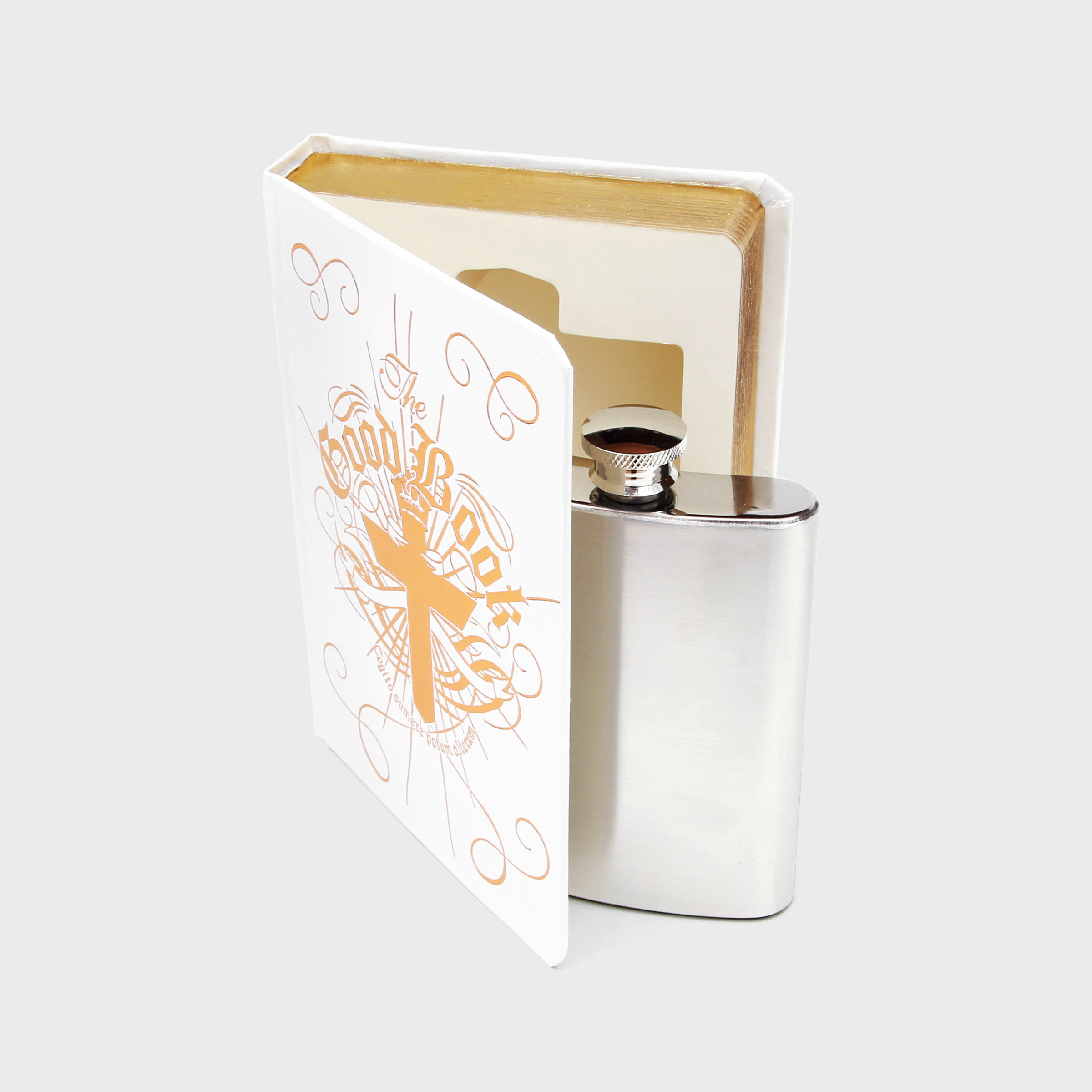 White and gold fancy flask in a book