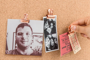 push pin with clips with photographs and tickets