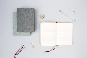 Cool linen covered notebooks on a desk