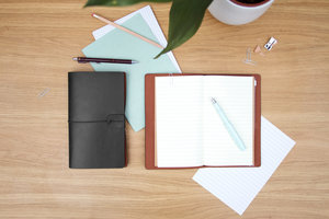 Black and brown faux leather notebooks
