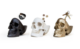 black white and gold skull gifts on white background