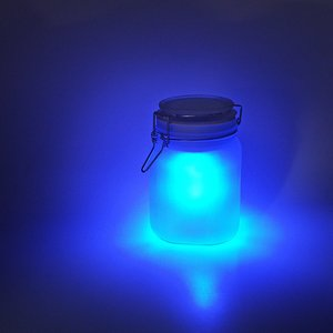 blue glowing jars indoors