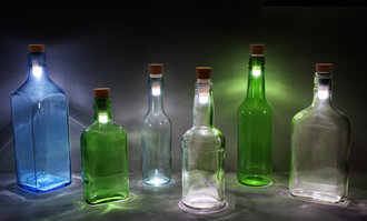 Create illuminating table features with rechargeable Bottle Lights.