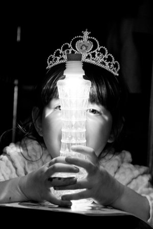 Child has fun with Bottle Light