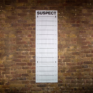Mugshot height chart on a brick wall with centimetres