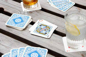 Playing cards with drink mats outside