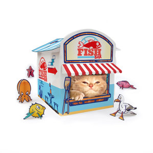 Ginger cat inside cardboard cat fish and chip shop with fold up toys