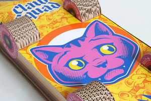 Illustrated cat face on scratching skateboard