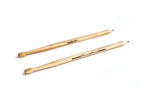 pair of wooden drumstick pencils shown on white table. great gift for drummers.