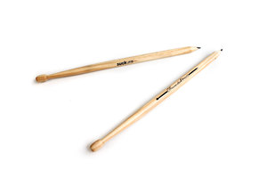 pair of wooden drumstick pencils shown on white table. Great gift for drummers and drawers.