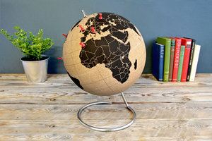 cork globes for office in front of books