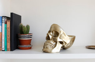 gold desk skull on table