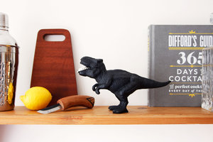 cast iron dinosaur bottle opener with cocktail shaker and chopping board
