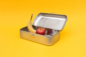 Open fridge lunch box with an apple and banana inside