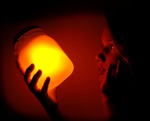 girl holding solar jar in the dark