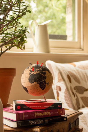 small globe to mark travels