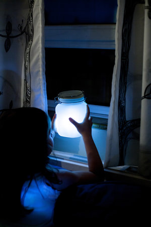glow in the dark jar near window at night