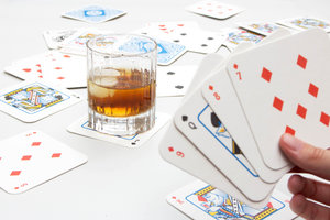 Playing cards with beer mats