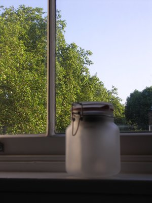 light jars near the window during day