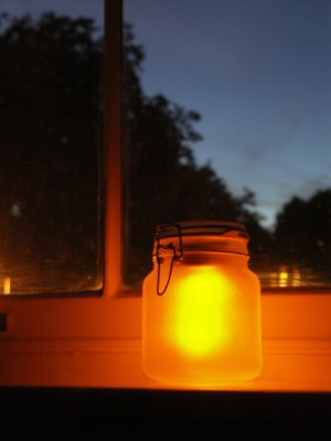 light jars near the window during night