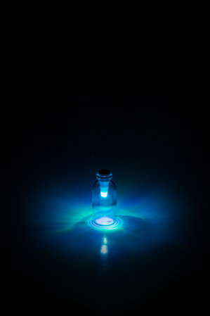 Multi-colour Bottle light by SuckUK - twist to select colour: Cyan light in glass bottle.