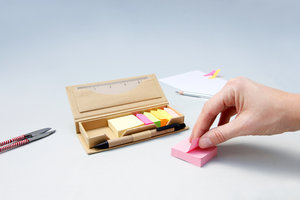 hand taking sticky note from memo set