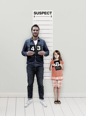 Father and daughter posing for a height chart photo