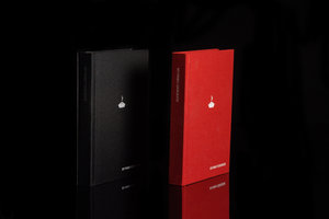 Red and black options for My Family Cookbook. A blank recipe book. shown at an angle.