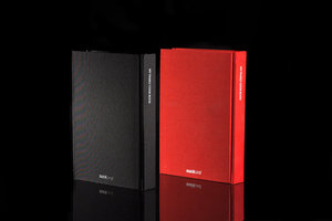 Red and black notebooks. Options for My Family Cookbook. A blank recipe book. Back covers showing.