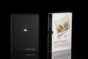 My Family Cookbook. Black hardback notebook with slip case. Shown on black background.