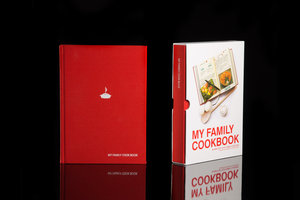 My Family Cookbook. Red hardback notebook with slip case. Shown on black background.